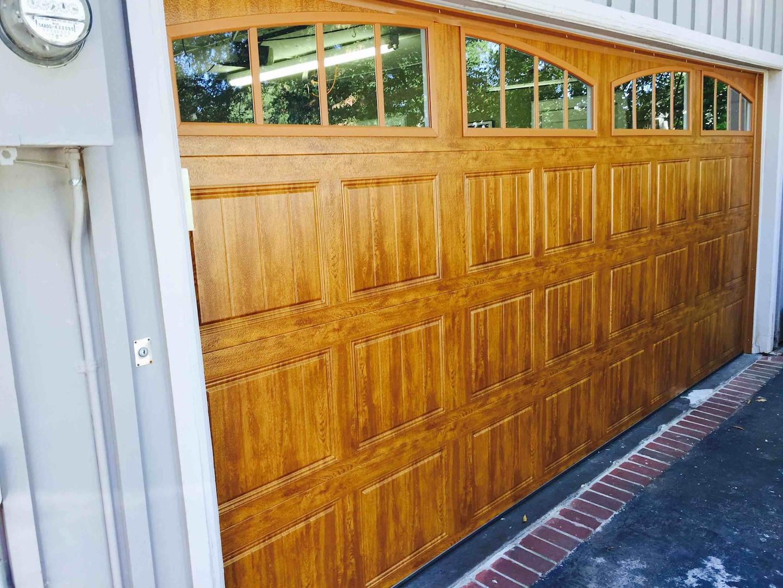 MANNAS GARAGE DOOR