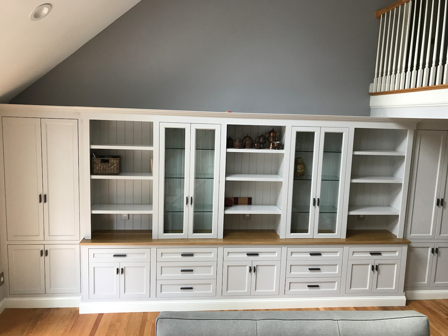 Handcrafted cabinets in living room and mud room in Newton