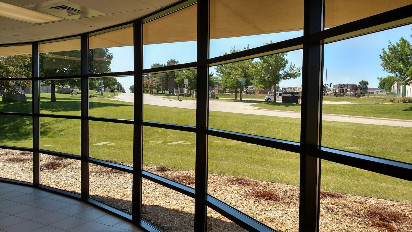 Touch of Glass Window Tinting and Blinds